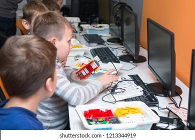 Minsk, Belarus. October, 2018. Elementary STEM school. Teenager boy constructs and programmes Lego Robot WeDo. Stem education. Robotics school. Workshop.