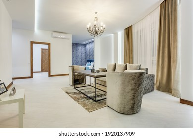 MINSK, BELARUS - OCTOBER 2020: Interior of the modern guestroom in studio apartments or hotel with sofa table armchairs and led light