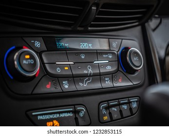 MINSK, BELARUS - OCTOBER 25, 2018: Climate control unit of a modern SUV Ford Escape. Climate system allows separate temperature adjustement for driver's and passenger's side.