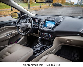 MINSK, BELARUS - OCTOBER 25, 2018: Interior of a modern SUV Ford Escape. The top-of-the-range Titanium model has handsome leather-trimmed seats, metallic trim, and power-operated front seats.