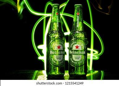 MINSK, BELARUS - October 29, 2018: Bottle of Heineken Premium Lager Beer with Water drops. Heineken is a premium brand lager beer brewed in Holland by the Heineken Brewing Company