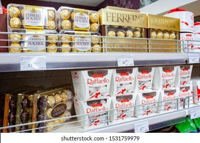MINSK, BELARUS - October 6, 2019: Raffaello and Ferrero Rocher candy from Ferrero company on supermarket shelves.