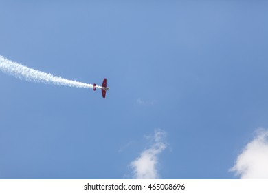 """Minsk, Belarus on 31 July 2015. Air sports festival """"ProNebo 2016"""". Acrobatics Stunt Plane Performing Elements in Air."""