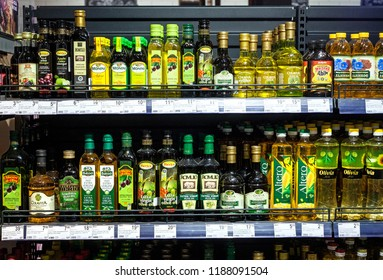 Minsk, Belarus, September 1, 2018: Different oils on the storefront in the supermarket. Olive, corn, sunflower and other oil.