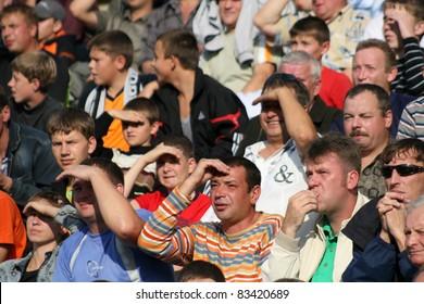 MINSK, BELARUS - SEPTEMBER 13: Match DYNAMO minsk VS TORPEDO Jodino, soccer fans watching match on September 13,2009 in Minsk, Belarus
