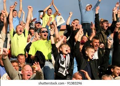 MINSK, BELARUS - SEPTEMBER 13: Match DYNAMO Minsk VS TORPEDO Jodino, unidentified soccer fans celebrating goal on September 13, 2009 in Minsk,  Belarus