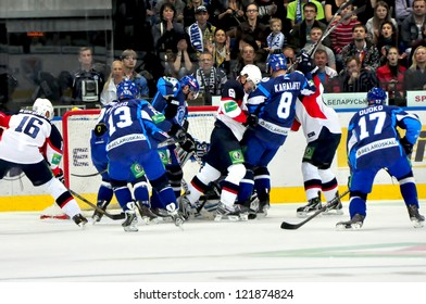 MINSK, BELARUS - SEPTEMBER 13: Unidentified players (Dynamo (blue) in defence during KHL regular match Dynamo Minsk VS Slovan Brotislava on September 13, 2012 in Minsk, Belarus.