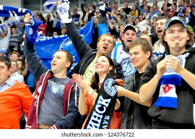 MINSK, BELARUS - SEPTEMBER 13: Unidentified spectators celebrate a goal during KHL regular match Dynamo Minsk VS Slovan Brotislava on September 13, 2012 in Minsk, Belarus.
