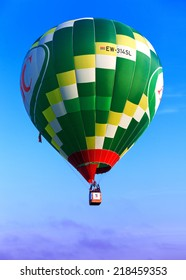 Minsk, Belarus - September 14, 2014: The FIRST OPEN CHAMPIONSHIP of Belarus on aeronautic sports.Green flying balloon.