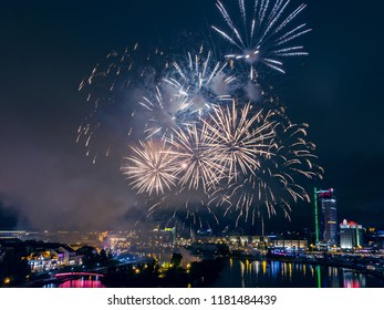 Minsk, Belarus - September 15, 2018: Festive fireworks above Minsk downtown at night during moto fest H.O.G. Rally Minsk closing. City downtown, panoramic photo.