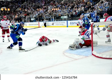 MINSK, BELARUS - SEPTEMBER 15:Alexander Kitarov (Dynamo #77) scores the goal during KHL regular match Dynamo Minsk VS CSKA Moskow on September 15, 2012 in Minsk, Belarus.