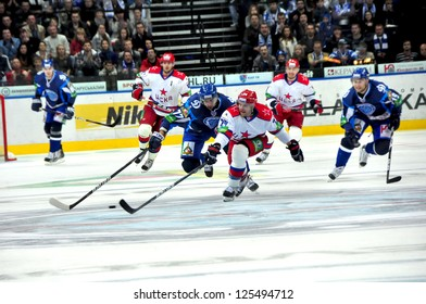 MINSK, BELARUS - SEPTEMBER 15:Alexander Kitarov (D. #77) and Mikko Maenpaa (#24) fighting for the puck during KHL regular match Dynamo Minsk VS CSKA Moskow on September 15, 2012 in Minsk, Belarus.
