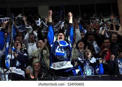 MINSK, BELARUS - SEPTEMBER 15:Unidentified Dynamo fans celebrate a goal during KHL regular match Dynamo Minsk VS CSKA Moskow on September 15, 2012 in Minsk, Belarus.