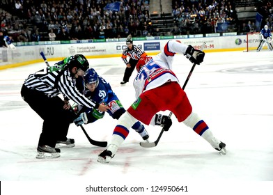MINSK, BELARUS - SEPTEMBER 15:Unidentified referee throwing a puck during KHL regular match Dynamo Minsk VS CSKA Moskow on September 15, 2012 in Minsk, Belarus.