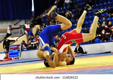 MINSK, BELARUS - SEPTEMBER 16: Unidentified wrestlers fighting in the pit during Grand Prix for the prizes A.Medved in freestyle wrestling on September 16, 2012 in Minsk, Belarus.
