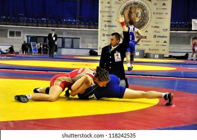 MINSK, BELARUS - SEPTEMBER 16: Unidentified female wins by fall during Grand Prix for the prizes A.Medved in freestyle wrestling on September 16, 2012 in Minsk, Belarus.