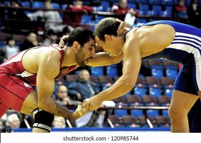 MINSK, BELARUS - SEPTEMBER 16: Unidentified wrestlers compete during Grand Prix for the prizes A.Medved in freestyle wrestling on September 16, 2012 in Minsk, Belarus.