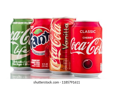 MINSK, BELARUS - SEPTEMBER 19, 2018: Classic Coca Cola can, Life, Cherry, Vanilla, Fanta Strawberry. Coca-Cola Company is the most popular market leader carbonated soft drink