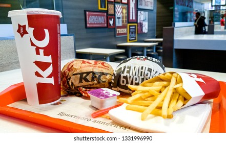 Minsk, Belarus, september 19, 2018: Burgers, French fries and paper cup with KFC logo on a tray in KFC Restaurant