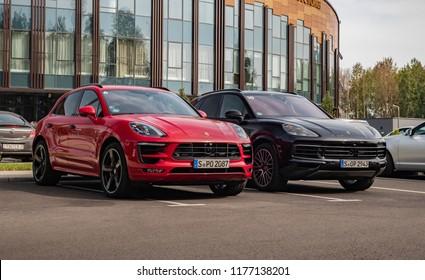 MINSK, BELARUS - SEPTEMBER 2, 2018: Porsche Cayenne Turbo and Macan Turbo parked outside.