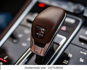 MINSK, BELARUS - SEPTEMBER 2, 2018: Photo of a compact gearshift selector in the interior of the newest Porsche Panamera Turbo S.