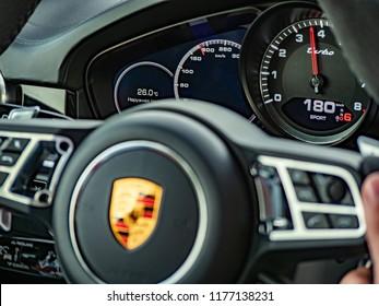 MINSK, BELARUS - SEPTEMBER 2, 2018:  Image of speedometer and tachometer of Porsche Panamera Gran Turismo. The speedometer showing fast speed.