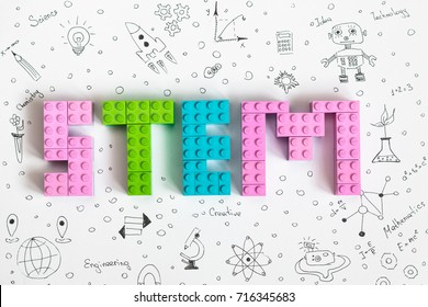 "Minsk, Belarus - September, 2017:  Academic year. STEM education. Robot. Books. Microscope and test tubes. Flowers. Drawing background with lego word ""STEM"". Concept."