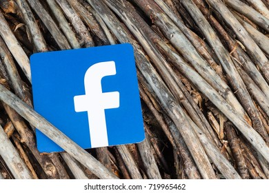 Minsk, Belarus - September, 2017: Printed on paper logos of the famous social network Facebook. Old wooden are on the background. Concept.