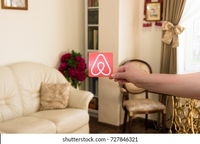 Minsk, Belarus - September, 2017: Travel around the world with Airbnb. Logo Airbnb and the house interior