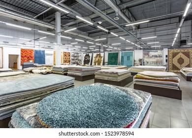 MINSK, BELARUS - SEPTEMBER, 2019: inside interior of elite store of machine knitted handmade carpets.