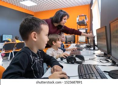 Minsk, Belarus. September, 2019. Teenager boys are programming on Scratch. Computer. Scratch programme. STEM education. Coding. Teacher at school. Classes.