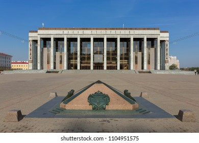 Minsk, Belarus - September 27, 2017: The symbol of zero kilometer monument and Palace of the Republic on October Square in Minsk, Belarus