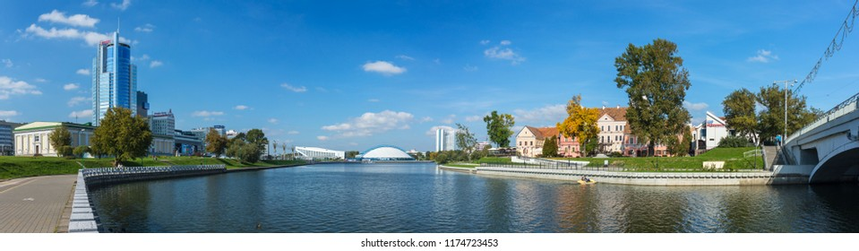 Minsk, Belarus - September 27, 2017: Panorama view of Svisloch riverwith Traetskae Pradmestse (Trinity Suburb) and new modern buildings in Minsk city center.