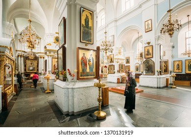 Minsk, Belarus - September 3, 2016: Woman parishioner praying in Cathedral Of Holy Spirit In Minsk. Main Orthodox Church Of Belarus And Symbol Of Old Minsk. Famous Landmark