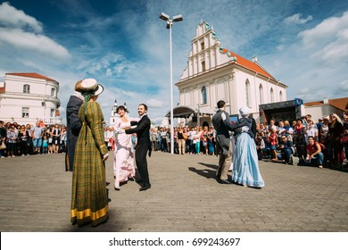 Minsk, Belarus - September 3, 2016: Couple of young people dressed in clothes of the 19th century dancing Polonaise at the celebration of the Day of Minsk city in a historic area Nemiga.