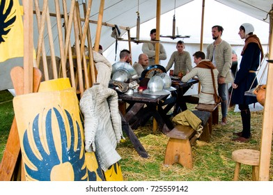 Minsk, Belarus - September 9, 2017: Medieval knights are sitting at a table in a tent