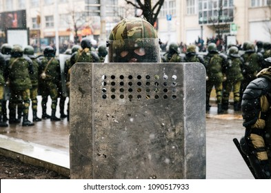 Minsk, Belarus. Special police unit with shields against protesters. Belarusian people participate in the protest against the decree 3 Lukashenko and the current authorities.