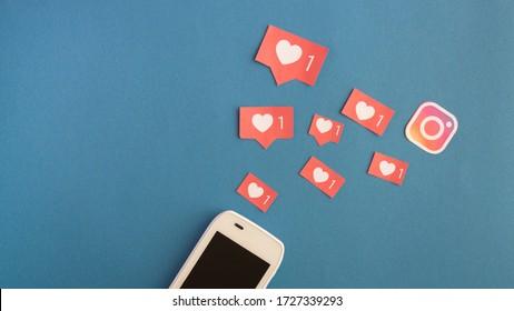 Minsk, Belarus-April 25, 2020: Instagram heart likes over dark blue background