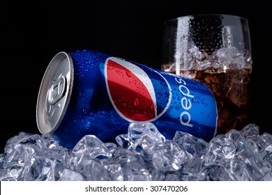 MINSK, BELARUS-AUGUST 16, 2015: Can and glass of Pepsi cola on ice. Pepsi is a carbonated soft drink that is produced and manufactured by PepsiCo. Created and developed in 1893.
