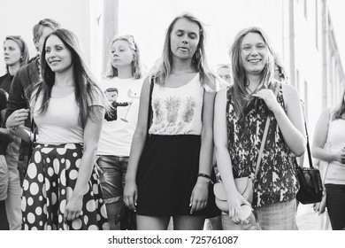 MINSK, BELARUS.August 19, 2017. Group of people laughing and posing in front of camera
