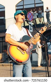 MINSK, BELARUS.August 19, 2017. A man with a guitar sings on the street