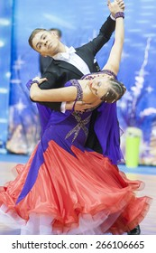 Minsk, Belarus-February 15, 2015: Dance Couple of Shmidt Danila and Alina Gumenyuk Performs Youth-2 Standard Program on IDSA World Professional 10 Dance Championship on February 15,2015,Minsk, Belarus