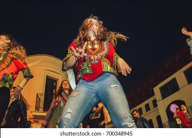 MINSK, BELARUS.JULY 29, 2017. Afro man sings and dances at night on the street