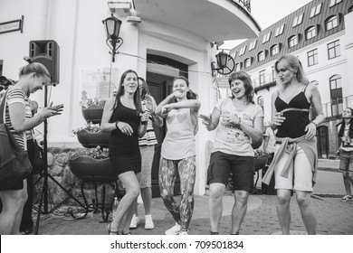MINSK, BELARUS.JULY 29, 2017. Group of people laughing and posing in front of camera