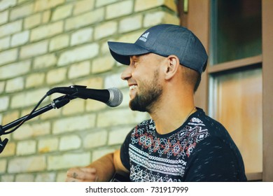 MINSK, BELARUS.JULY 29, 2017. A man with a guitar sings on the street