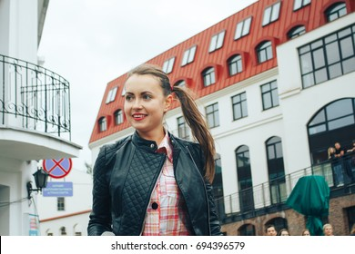 MINSK, BELARUS.JULY 29, 2017. Woman with a microphone sings on the street