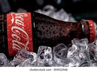 MINSK, BELARUS-MARCH 22, 2016: Bottle of Coca-Cola with ice. Coca-Cola is a carbonated soft drink sold in stores, restaurants, and vending machines throughout the world.