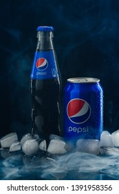 MINSK, BELARUS-MAY 08, 2019: Beverage canister and bottle Pepsi with smoke and ice. Pepsi is a carbonated soft drink produced and manufactured by PepsiCo. Editorial.