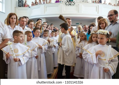 Minsk, Belarus-May 2018: ceremony of the first communion in the church, religious holiday