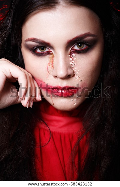 MINSK, BELARUS-OCTOBER 11, 2016: Beauty fashion portrait. Girl model. Creative make-up. Lady in Red. Saint Valentine. smeared lipstick